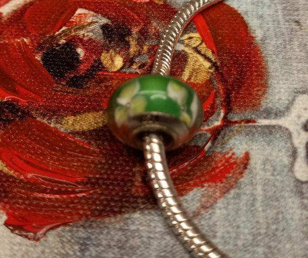 Green silver charm with white & yellow flecks