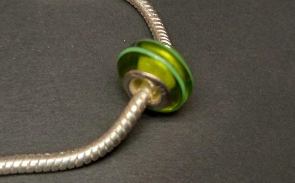 Green silver charm